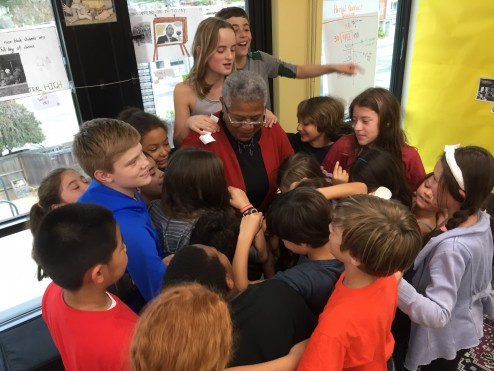 Fifth Grade students embrace Minnijean after thoughtful dialogue