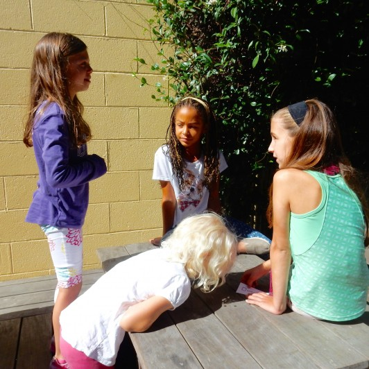 <em>First and Fourth Grade Buddies work together to plan a silent skit that displays an assigned emotion.</em>