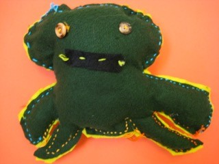 A stuffy doll sewn by a First Grade student.