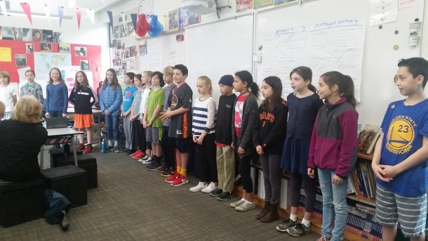 "Students open the community share reciting the poem ""Home"" by Warson Shire."
