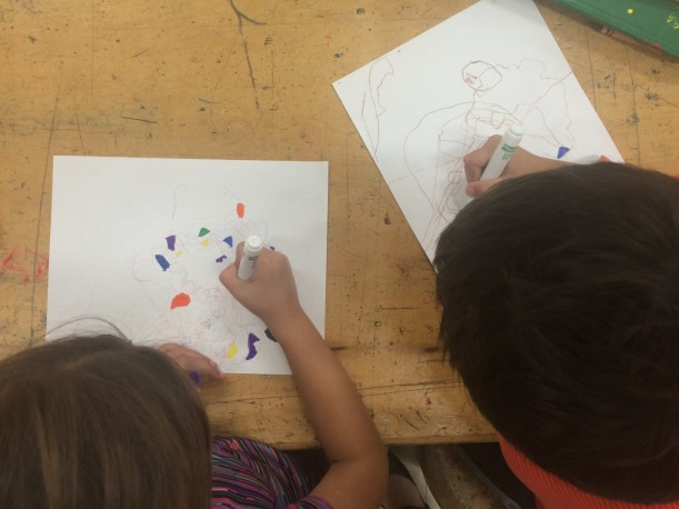 Capture the Light: Students use colored pencils and markers to finish the pieces