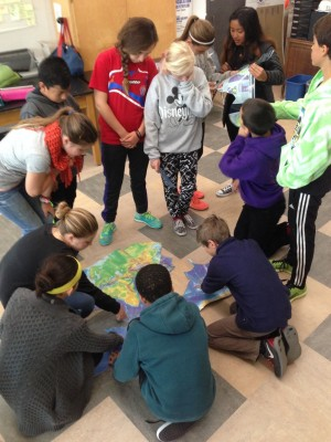 To gain better understanding of plate tectonics, students cooperatively put together a giant puzz...